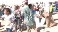IŞİD Zulmünden Kaçan Baba Yaralı Oğlunu Kucağında Böyle Taşıdı
